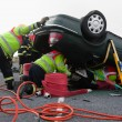 Firemen with equipment at car crash — Stock Photo