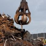 Crane grabber loading metal scrap, Monochromatic — Stock Photo