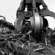 Crane grabber loading metal scrap, Monochromatic — Stock Photo