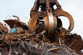Crane grabber loading metal scrap — Stock Photo