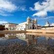 Church of Santa Maria reflected in the water - Stock Photo