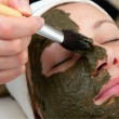 Stock Photo: Applying beauty mask