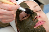 Applying beauty mask — Stock Photo