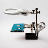 Magnifying glass tool and hard drive — Stock Photo