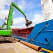 Stock Photo: Crane Loading ship with steel