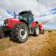 Tractor collecting haystack in the field — Stock Photo #6212291