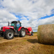 Tractor collecting haystack in the field — Stock Photo #6326800