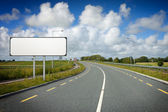 Motorway with white road sign — Stock Photo