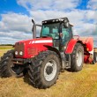 Tractor collecting haystack in the field — Stock Photo