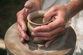 Hands of the potter — Stock Photo