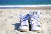 Sneakers on the beach — Stock Photo