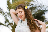Girl with the flower in her hair — Stock Photo
