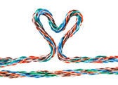 Heart with multicolored computer cable — Stock Photo