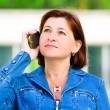 Middle-aged woman with cellphone — Foto Stock