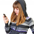 Stock Photo: Teenage girl typing sms