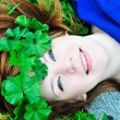 Stock Photo: Redheaded girl with crown from leaves