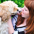 Redheaded girl having fun with her dog — Stock Photo