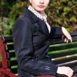 Serious lady on the bench — Stock Photo #5620344