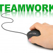 Hand with computer mouse and word Teamwork — Stock Photo