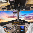 Pilots in the plane cockpit and sunset — Stock Photo
