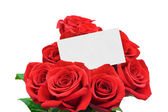 Paper card and roses — Stock Photo