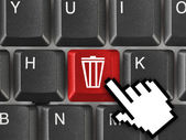 Computer keyboard with garbage key — Stock Photo