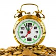 Alarm clock and coins — Stockfoto