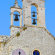 Bell tower with clock, Church of St. Barbara at Sibenik, Croatia - Stock Photo