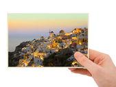 Fotografía de santorini en mano — Foto de Stock