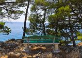Coast, bench and sea at Brela, Croatia — Stock Photo