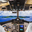 Pilots in the plane cockpit and island — Stock Photo