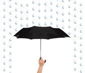 手与伞和雨 — 图库照片