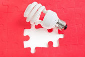 Lamp and puzzle — Stock Photo