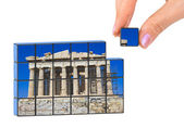 Hand and Parthenon (my photo) puzzle — Stock Photo
