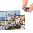 Hand and Santorini (my photo) puzzle - Stock Photo