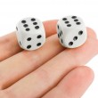 Two dices in hand — Stock Photo #5895325