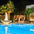 Water pool and fountain at night - Stock Photo