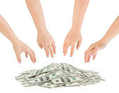 Hands and money heap — Stock Photo