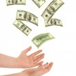 Hand and falling money — Stock Photo