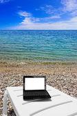 Netbook on beach — Stock Photo