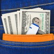 Stock Photo: Money and flash memory in jeans pocket
