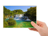 Krka waterfall (Croatia) photography in hand — Stock Photo