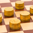 Money on chess board — Stock Photo