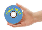 Hand with disk Solutions — Stock Photo