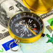 Compass and money — Stock Photo