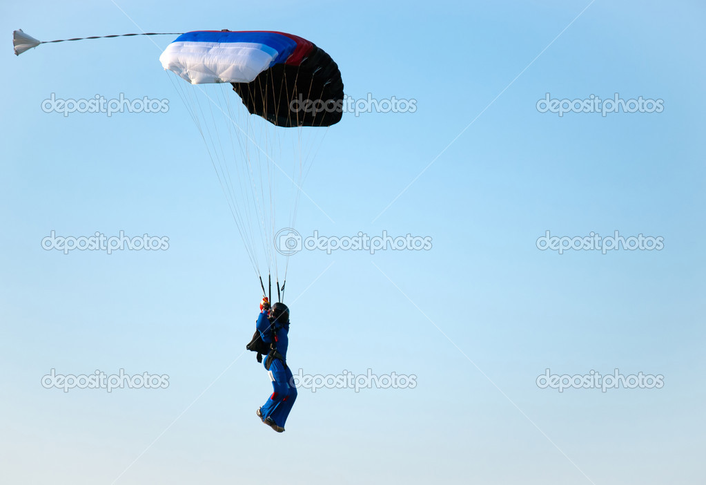 The man ready for landing with parachute  Stock Photo #6375193