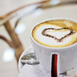 Cappuccino with chocolate heart - Stock Photo