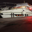 Private yacht at night - Stock Photo