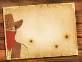 Old paper background with image of bandit and bullete holes.WEst — Stock Photo