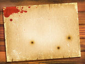 Old paper texture with red blood on wood background.Retro — Stock Photo